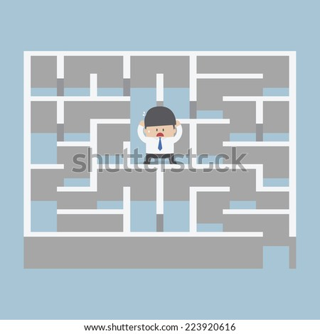 Businessman standing in center of the maze, VECTOR, EPS10 - stock vector