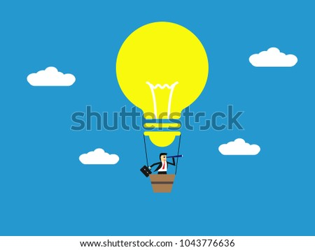 businessman with binoculars on Light bulb balloon flying in the sky,strong idea,business concept