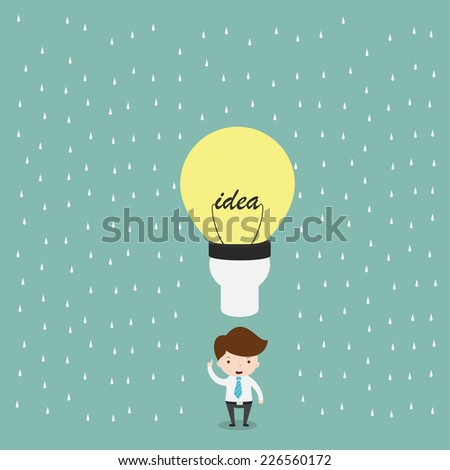 Businessman with bulb light idea in rain.