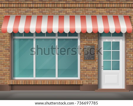 Cafe Or Store Front With Large Transparent Window And Awning Facade Of Red Brick