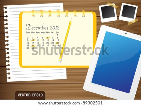 Calendar 2012 December on paper yellow Notebook.  With Fictitious touch tablet PC and photo frame. on brown wood background. Vector template for design work - stock vector