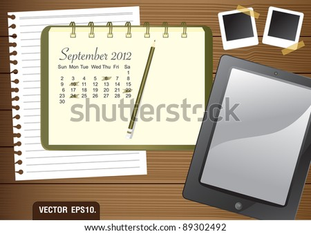 Calendar 2012 September on paper green Notebook.  With Fictitious touch tablet PC and photo frame. on brown wood background. Vector template for design work - stock vector