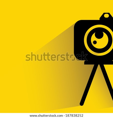 camera on yellow background, shadow and flat style - stock vector