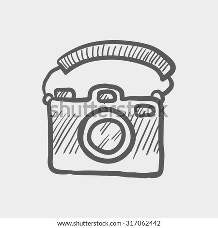 Camera sketch icon for web, mobile and infographics. Hand drawn vector dark grey icon isolated on light grey background.