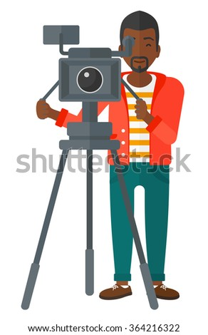 Cameraman with movie camera. - stock vector