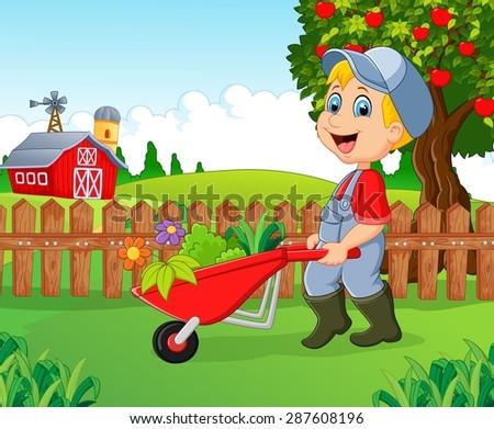 Cartoon little boy holding wheelbarrow , - stock vector