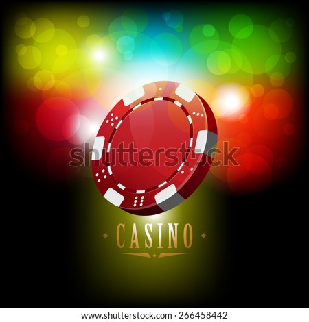 Casino chip on shiny background with bokeh