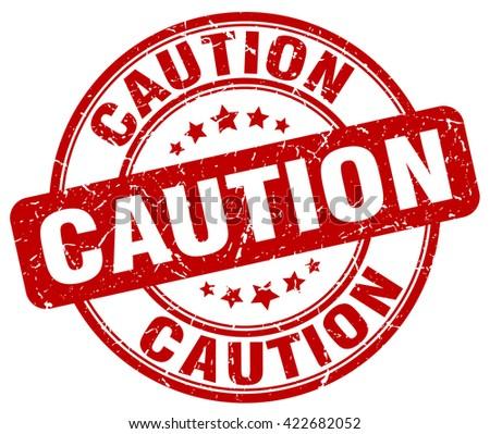 caution red grunge round vintage rubber stamp.caution stamp.caution round stamp.caution grunge stamp.caution.caution vintage stamp. - stock vector