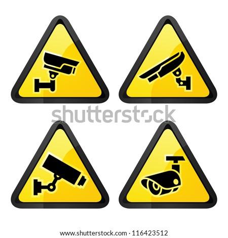 CCTV triangular labels, set symbol video surveillance - stock vector