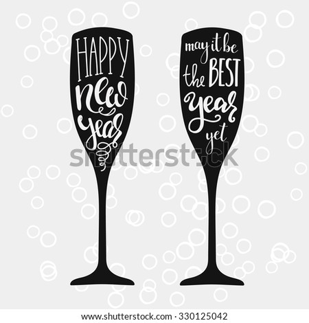 Champagne New Years lettering modern calligraphy set on champagne glass shape isolated vector typography elements. Happy new year. May it be the best year yet. - stock vector