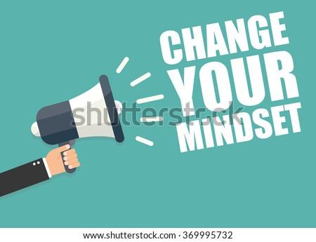 Change your mindset. Hand holding megaphone - stock vector