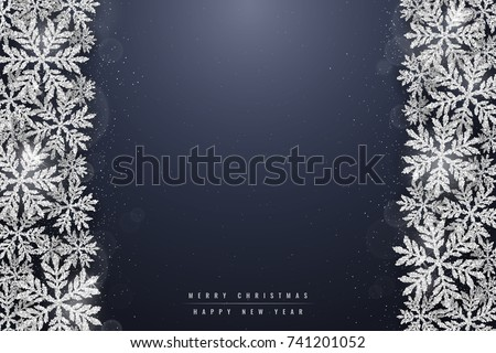 Christmas and new year dark blue background with christmas silver glittering snowflakes on dark background. Merry Christmas greeting card