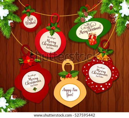 Christmas and New Year greeting cards hanging on xmas tree branches with holly berry, bell, ribbon bow and poinsettia flower on wooden background. Winter holidays festive poster design