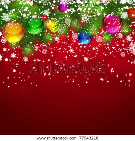 Christmas background with snow-covered branches of Christmas tree, decorated with Christmas balls.