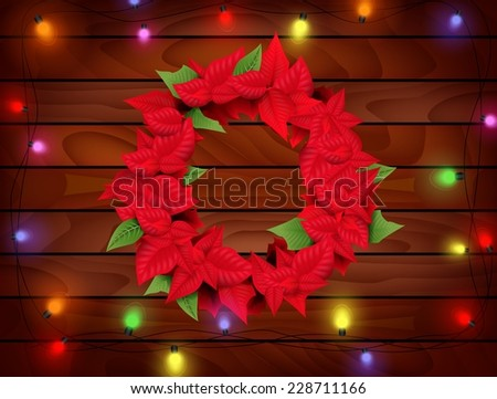 Christmas Decoration with Poinsettia (Euphorbia pulcherrima) on wooden background