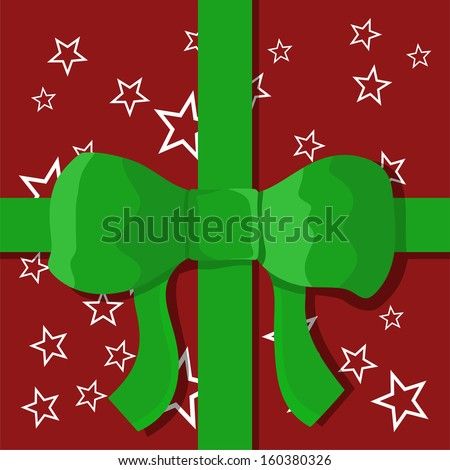 Christmas gift in wrapping paper and green ribbon