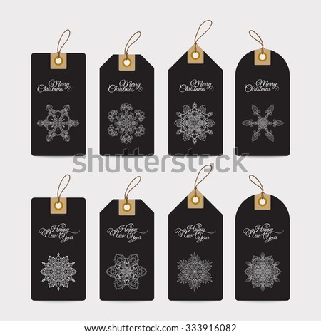 Christmas gift tags with hand drawn decorative elements.  White snowflakes on black background. - stock vector