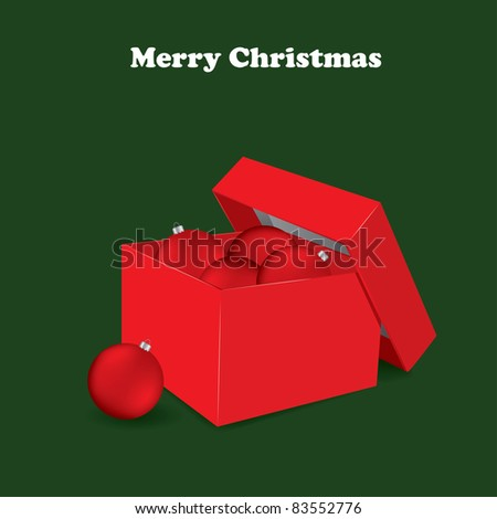 Christmas greeting card with red balls in the box