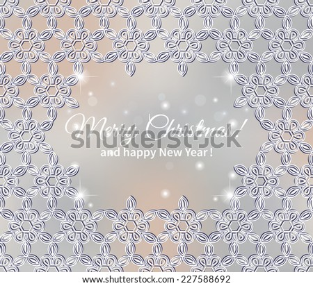 Christmas lace frame with abstract snowflakes on blurred background