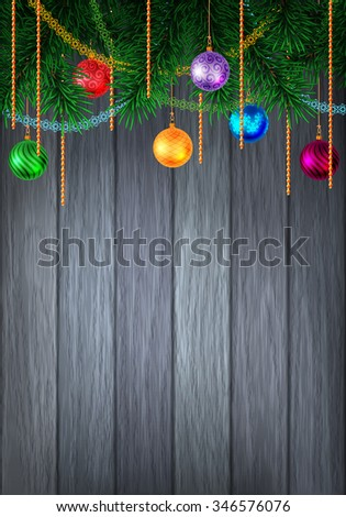 Christmas or New Year colorful greeting card with evergreen pine branch and baubles with tinsel. Decorated wood background. Vector illustration