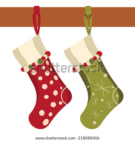 Christmas socks hung on a white background - stock vector
