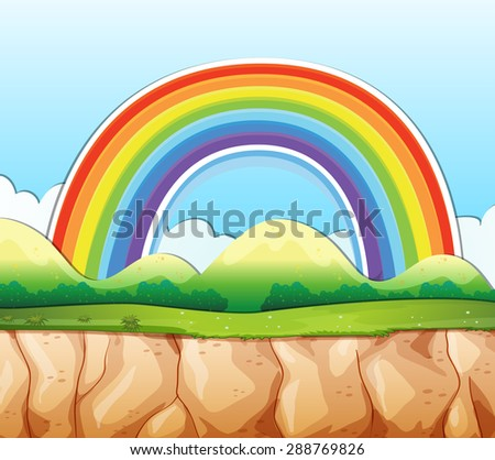 Cliff with rainbow over the mountain