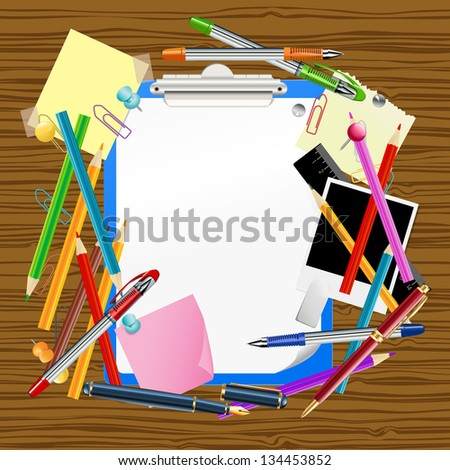 clipboard with assorted office supplies