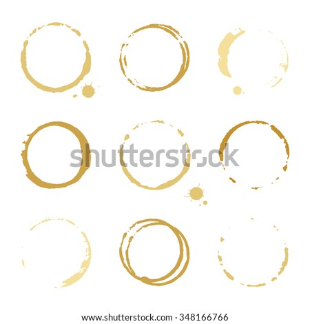 Collection of gold round stains and blots on white background