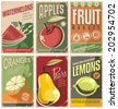 Collection of retro fruit poster designs. Vintage vector food signs set with promotional messages. - stock vector