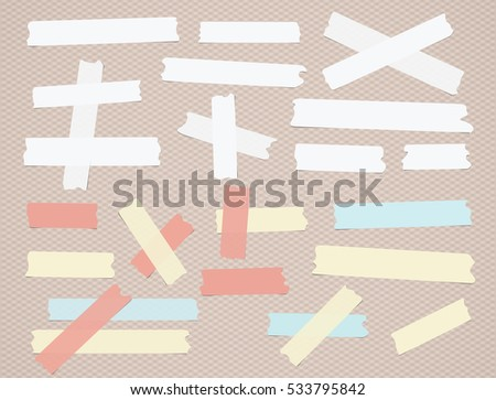 Colorful and white different size paper sticky, masking tape are on brown background