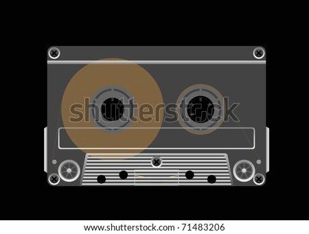 Compact cassette tape on a black background is shown in the picture