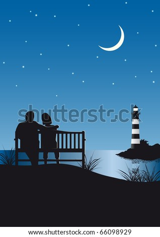 couple watching a lighthouse by night
