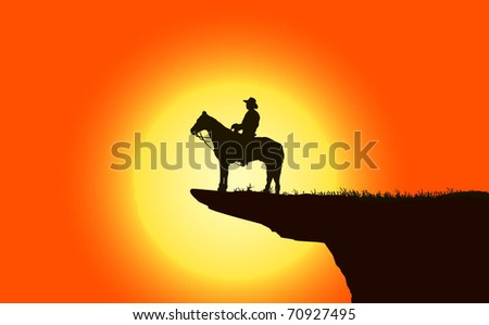 Cowboy over mountain at sunset