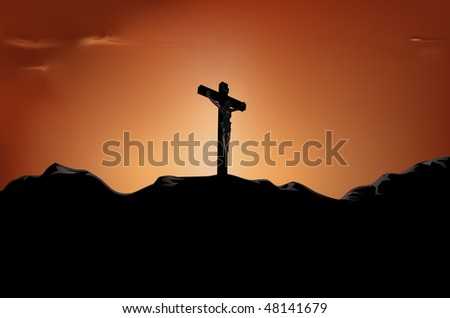 crucified Jesus on cross in the sunset