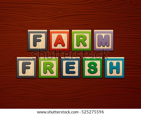 "Cubes with letters ""Farm Fresh"" on wooden board for Web, Mobile"