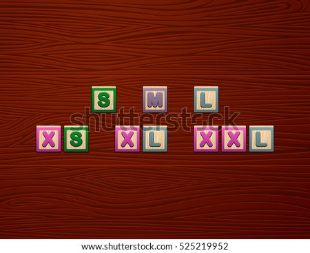 "Cubes with letters ""S M L XS XL XXL"" on wooden board for Web"