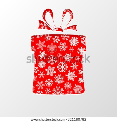 Cut out the paper in shape gift box for Christmas, with white snowflakes on red background