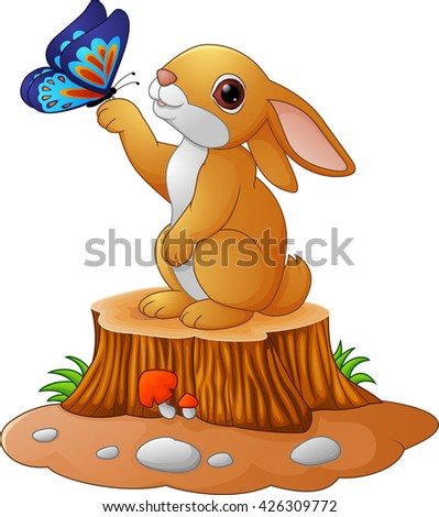 Cute bunny standing on tree stump