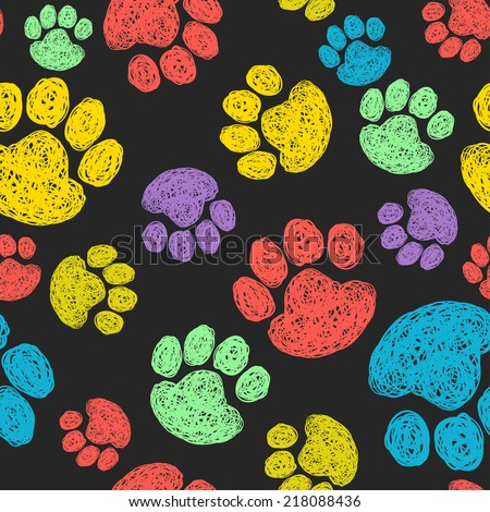 Cute seamless pattern with colorful hand drawn doodle paw prints. Animal tiling background. - stock vector