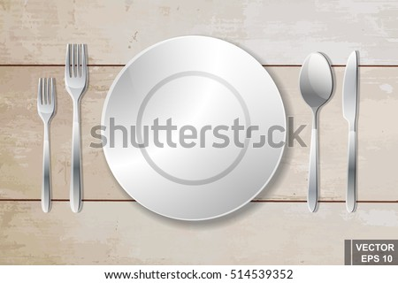 Cutlery. Spoon, fork, knife and plate. Serving. Preparing for dinner.