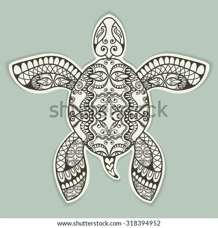 Decorative turtle with ethnic ornament in cut out style with shadow, vector tribal totem animal, isolated element for scrapbook, invitation or greeting card design  - stock vector