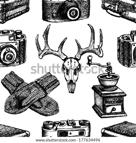 Deer skull, suitcase, mittens, coffee mill and retro photo camera ...