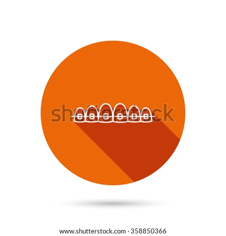 Dental braces icon. Teeth healthcare sign. Orthodontic symbol. Round orange web button with shadow. - stock vector