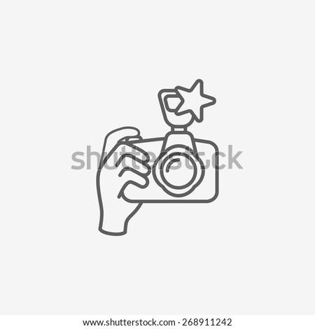 digital photo camera in hand - stock vector