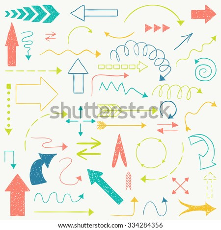 Doodle set of arrows. Hand drawn arrows sketched style. - stock vector