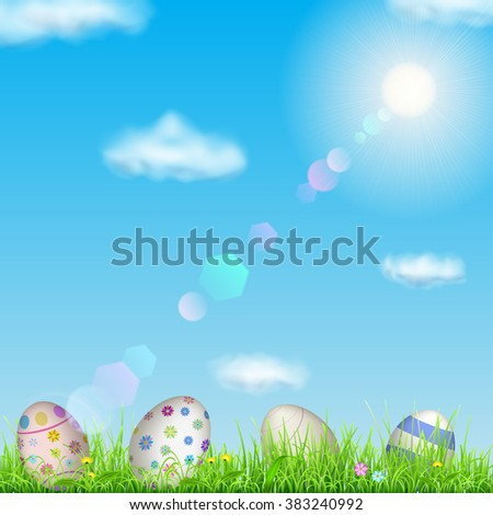 Easter background with sky, sun, grass, easter eggs and flowers