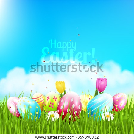 Easter greeting card with colorful eggs and flowers in the grass