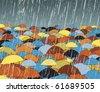 Editable vector illustration of colorful umbrellas in rain - stock photo