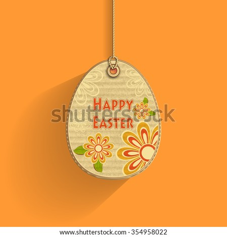 Egg on cord with  corrugated cardboard texture and flowers on orange background  frame of  celebration  Easter