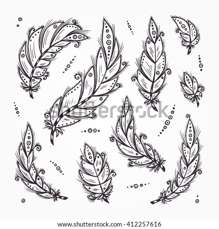 Ethnic feathers. Feathers Vector Set. Hand Drawn Doodle Bird feathers. Tribal Feathers. - stock vector